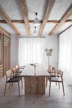 Loft Kolasinski - House renovation with original features. Dining room with vintage chairs and wooden table designed by Loft Kolasinski. White dining room with exposed beams and white curtains. #wabisabi #scandinavianliving #homedecor #diningroom