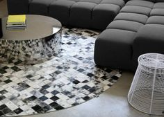 This checkered rug is actually made of little squares of cowhide. #clublocal