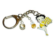 New item (Betty Boop in yellow with flowers and crystals. Key ring - Bag charm.) is available at Rob's Emporium - http://robsemporium.com/product/betty-boop-in-yellow-with-flowers-and-crystals-key-ring-bag-charm/