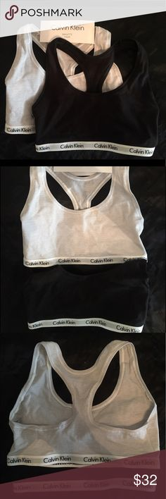 Calvin Klein 2 Pack Sport Bra Bralette These are brand new, tried on but wrong size. Still have tags. One is light grey & white striped, the other solid black with the CK classic band. Size small. This is definitely for an A cup. Size 0 or extra small, 30-32 inch bust. Calvin Klein Intimates & Sleepwear Bras