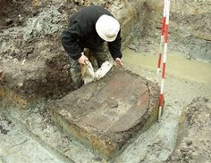 16 September: Archaeologist Peter Mandrup removing the cover of a well-preserved 10th-century Viking shield some 60 miles west of Copenhagen, Denmark.