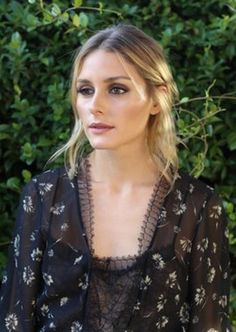 Who made  Olivia Palermo's black floral lace dress?