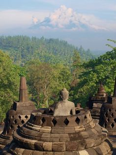 Budha in Borobudur temple and Merapi Volcano, Jogja, Indonesia
