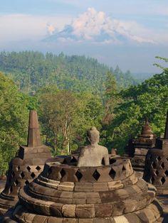 Budha in Borobudur temple and Merapi Volcano, Jogja, Indonesia