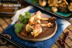 Easy baked chicken appetizer recipe, tulip shaped chicken drumettes with a spicy miso dipping sauce.