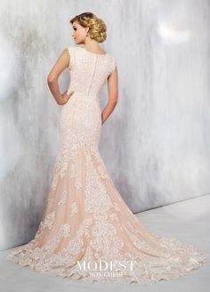 Modest Wedding Dresses TR21712 - Tulle fit and flare gown with embroidered lace appliques features cap sleeves, wide scalloped V-neckline, scattered hand pattern beaded bodice with dropped waist, overskirt spills into chapel length train, scalloped hem.