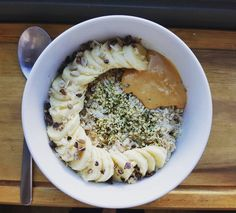 Coconut Milk Cinnamon Hemp Porridge by @thevegscene  So this hot cinnamon porridge mixed with left over coconut milk I had from my stew (previous post)  I've topped it with sliced banana shelled hemp seeds roasted almond butter and cacao nibs. Felt like a toned down satiating and simple breakfast today and the combo with the coconut milk works really well together. . .  #breakfastbowl #breakfast #recipe #newrecipe #veganrecipe #morning #hempseeds #banana #granola #nutbutter #cacaonibs…