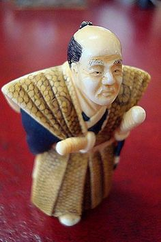 A Japanese Carved Ivory Netsuke of a Samurai  Holding a Letter Behind His Back. Signed by  the Artist, Late 19th Century
