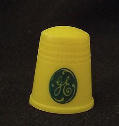 Vintage G E advertising plastic thimble