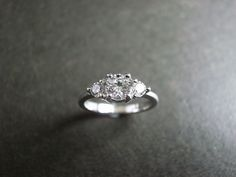 3 stone engagement ring but with diamonds around the band part.