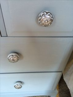 Final touch new drawer knobs - ceramic covered in a silver metal.