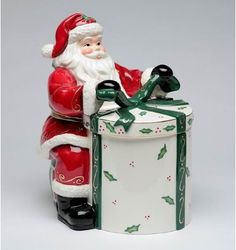 Santa Tying the Bow on a Gift Cookie Jar