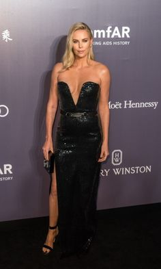 Charlize Theron shimmered in a plunging black Yves Saint Laurent gown on the carpet during the 2017 American Foundation for AIDS Research (amfAR) third annual Hong Kong gala at Shaw Studios. The star offered an exclusive opportunity during the events live auction: for two people to attend the New York City premiere of The Fate of the Furious, the eighth film in the epic Fast and the Furious franchise, along with tickets to the VIP after-party and a suite at The Peninsula New York. Her prize…