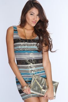 Youll sure be eye catching when you step out in this stylish dress! Youll love it the moment you try it on! Spice up your wardrobe and add it to your collection! Definitely a must have! It features striped pattern, metallic printed design, scoop neck, thick straps, cut out back, and fitted. 93% Polyester 6% Spandex. Made in USA.
