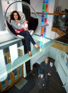 Seeing the light: Caroline and baby Mariella sit in the suspended bubble chair above the glass floor - beneath them are Mario, Angelina and . Bubble Chair, Glass Floor, Mario, Home And Family, Old Things, Bobs, Wicked, Chairs, Bedroom