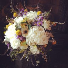 Bridal bouquet with lavender, dahlias, and peonies