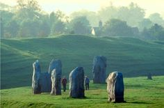 Avebury stones Wiltshire. Avebury in England is home to a 5000 year old neolithic monument. The site, a large henge with several stone circles and avenues, is a spiritual center among pagans and wiccans and is said to stand on the St Michael ley line. Nearly half of England's crop circles are located within 9 miles (15km) of the site.