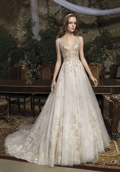 Cosmobella Gold Wedding Dress Style 7944 is so dreamy. Gold appliqué leaves encase the bodice of this v neck backless wedding gown. The Ivory Tulle skirt features pretty gold leaf and flower appliqués. Gold Wedding Gowns, Western Wedding Dresses, Lace Wedding Dress, Backless Wedding, Long Wedding Dresses, Perfect Wedding Dress, Wedding Dress Styles, Bridal Dresses, Ivory Wedding