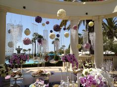 Love the use of floral pomander balls to decorate an outdoor wedding