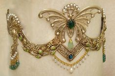 http://www.heartsongs-crystal-wands-crowns.com/Peacock_Butterfly_Crown_green_theme.jpg
