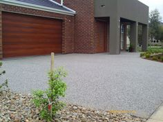 Image result for images of exposed aggregate concrete with brick inlayes