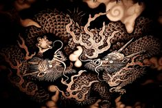 https://flic.kr/p/PzGZC5   Twin Dragons - Out of Darkness   location : Kenninji temple ,Kyoto city ,Japan      Fantastic frying dragons painting on zen temple ceiling  This painting commemorates the 800-year anniversary of Kenninji's founding, and a ceremony to mark its installation was given in April of 2002. It measures 11.4m by 15.7m (the size of 108 tatami mats) and is drawn with the finest quality ink on thick traditional Japanese paper.  It was created in the gymnasium of an…
