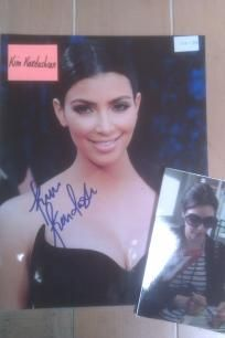Kim Kardashian Signed 8 1/2 x11 photo. Wow Hott !! http://yardsellr.com/yardsale/Erik-Marx-416944