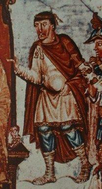 Abb. 4: Zur Zeit Karls des Kahlen († 877) trugen die fränkischen Adligen folgende Kleidungsstücke: einen Rock, der bis zu den Knien reichte und enge Ärmel aufwies, eine Hose, Beinbinden, die um die Unterschenkel gewickelt wurden, Bundschuhe und einen Mantel, der auf der rechten Schulter mit einer Spange geschlossen werden konnte. Dazu gehörte die kurze Ponyfrisur und der lang herabhängende Schnurrbart.