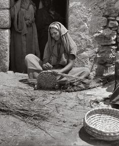 Woman weaving reed baskets. Bethlehem, Palestine. 1898-1946