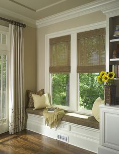 Custom finishes as this window seat at the back of the family room offers a cozy place to read with plenty of light. Built in custom bookshelves offer plenty of storage for family games, toys and everyday items needing to be tucked away. photography by John Umberger/ Real Images