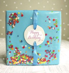 Confetti - The confetti shakes around between the double layers: the bottom layer is a traditionally wrapped package in a color and the outer layer is transparent wrapping paper so that you can see the confetti that is between these two layers. Fun!
