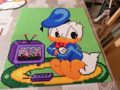 Baby Donald Duck hama perler beads by Hama Beads Disney, Hama Disney, Perler Beads, Fuse Beads, Hama Beads Patterns, Beading Patterns, Animated Disney Characters, Melty Bead Designs, Galerie Creation