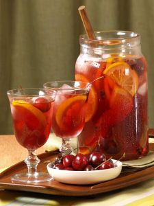 Sangria: 2 bottles of  cheap (but not gross) dry red wine,1.5 ounces or so of Brandy,1 can of 7 Up,1 ounce of O.J., 2 apples cut up small, 2 oranges cut up small,1 lemon cut up, 1 lime cut up.  Gets better the longer it sits, but can be drank right away as well.