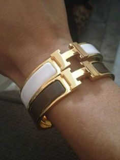 Hermes Cuff. If they made one for babies, it might fit my wrist...