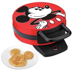 Disney Mickey Mouse Non-Stick Electric Waffle Maker, Red and Black  The only difference between this waffle maker and the silver classic one is, this has a cool Mickey Mouse on while the other is just stainless steel.  1 X Disney Mickey & Minnie Adore Bedding Set Double (Queen), Disney Mickey Mouse Non-Stick Electric Waffle Maker, Disney Mickey Mug Warmer, Disney's 2 Piece Mug Bundle Set Includes – One Mickey Mouse 18 oz Oval Ceramic Mug-Red and One Mini Mouse 18 oz Oval Ceramic Mug-White…