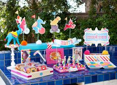 Take a hint from a party planning pro! Jennifer Sbranti of Hostess With the Mostess threw a colorful circus/carnival-themed bash with eye candy — and real candy! — as far as the eye can see for her daughter's first birthday.  Source: