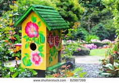 Beautiful bird house in a lush garden