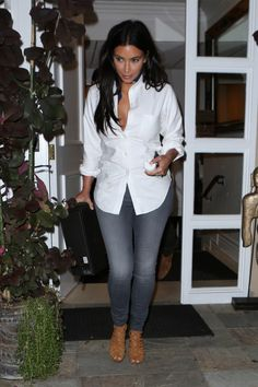 Kim Kardashian wearing Fidelity Ace Skinny Jeans in Vintage Graphite, Hermes Strappy Sandals.