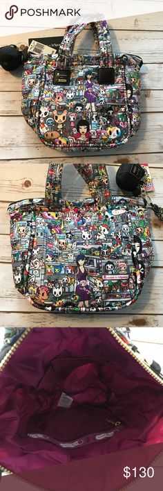 """Tokidoki for lesportsac small tote new with tags Small tote by tokidoki for LeSportsac in tokidopoli print. Has two of my favorites donutella and sandy print placement on the front and back. Size: 9.5"""" H x 9.5"""" W x 5"""" D. Top handles with a 6.5in (16.51cm) drop. Measurements taken from tokidoki site. Gorgeous deep Purple interior. Tokidoki zipper pull and detachable palette charm. New with tags! Smoke free dog friendly home. Always a bundle discount in my closet. Lesportsac Bags"""