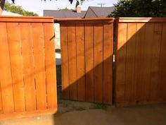 How to Building a Wooden Gate Wooden posts are combined with metal railings to create a decorative fence for a raised patio Building A Wooden Gate, Wooden Fence Gate, Wood Fences, Cedar Fence, Fence Building, Cedar Wood, Wood Pergola, Backyard Pergola, Pergola Kits