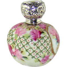 An Edwardian Silver capped perfume bottle, 1910.