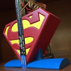 Display your Superman books, games, movies, and more with this amazing Superman logo bookend set! Hand painted in the Man of Steel's red, blue, and yellow, this limited edition bookend set measures ap