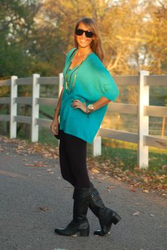turquoise sweater with black leggings and boots...simple but chic look