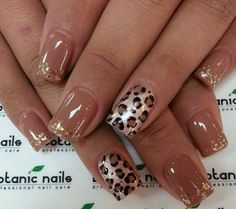 Light brown nails with gold glitter and leopard print accent nail.