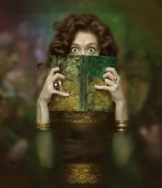 She's reading The Ghost by Sandra Brown Rarey. A chilling and unexpected Gothic Noir novel of desire and obsession.