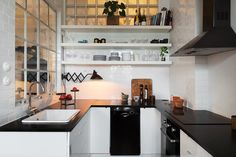 Love the use of a big window with the kitchen's third wall. An interesting take of a closed kitchen with an 'open' feeling.