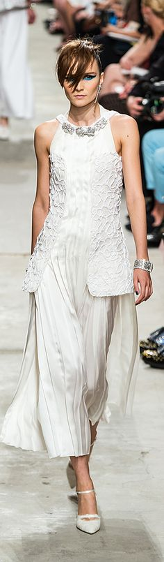Chanel Resort 2014 - WOW they rocked it in this white suit. Put this on ....add a pop of Red....hot pink...BLING it Up