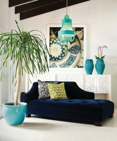 Royal blue chaise lounge, turquoise accents and peacock pillow!