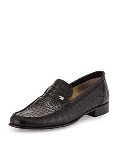 "Stefano Ricci slip-on loafer in crocodile. Moc toe. Notched vamp with signature eagle head plaque. Leather lining. 1"" stacked rubber heel. Made in Italy."