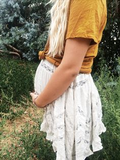 A tied-up tshirt over a foley dress! Perfect way to flatter your bump I like this dress!